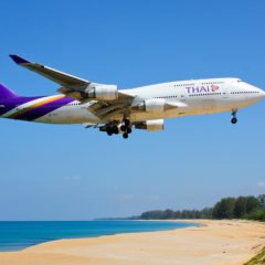 Phuket airport on Mai Khao Beach / Image via Andy Mitchell/ Flickr